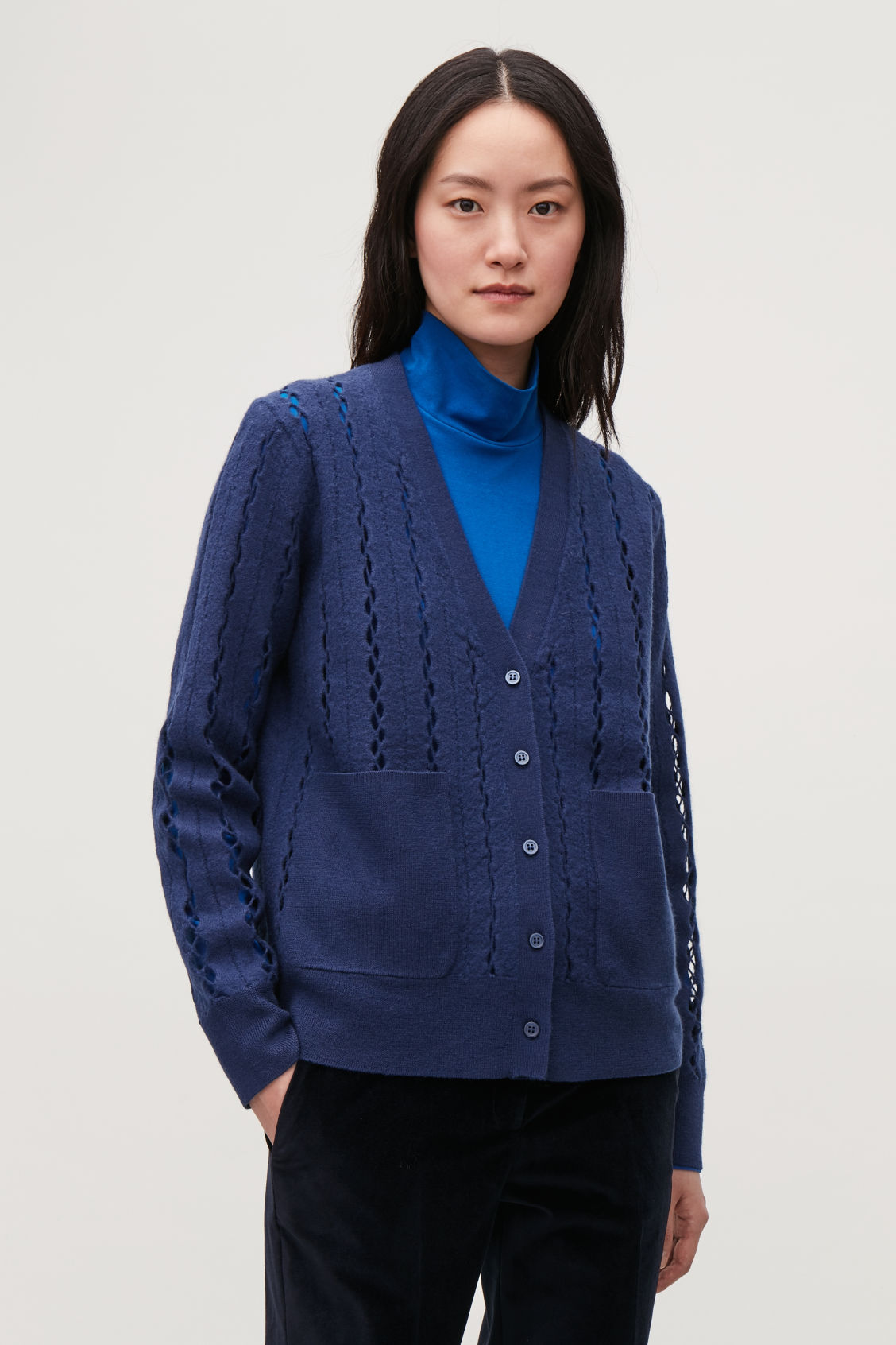 Model side image of Cos cut-out boiled wool cardigan in blue