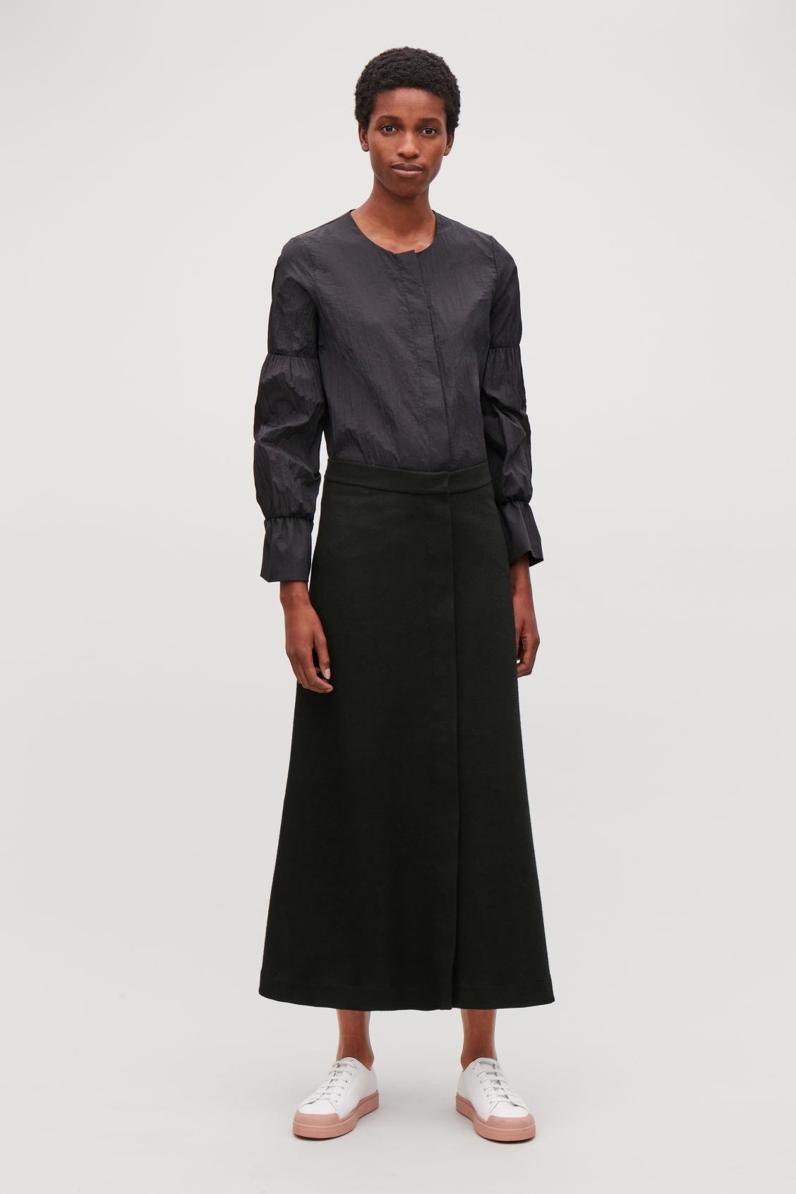 Model front image of Cos long wool-cotton skirt in black