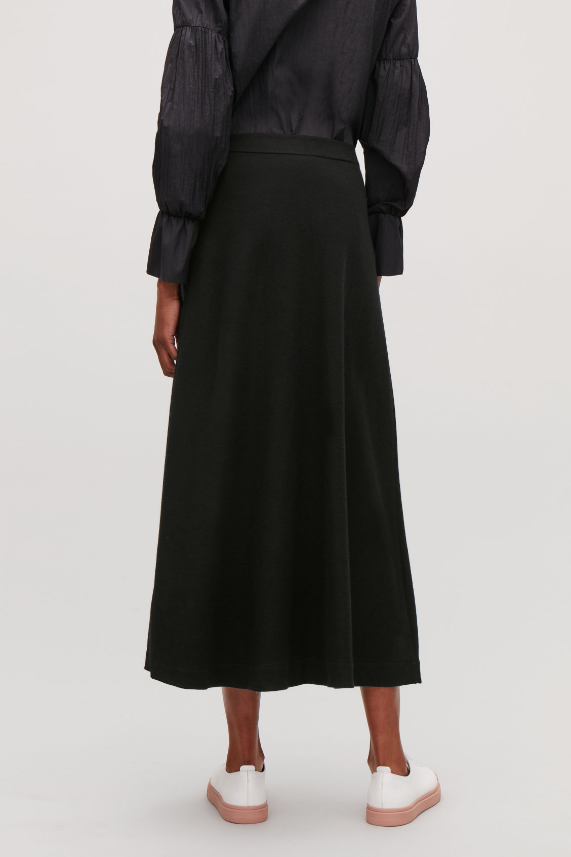 Model side image of Cos long wool-cotton skirt in black