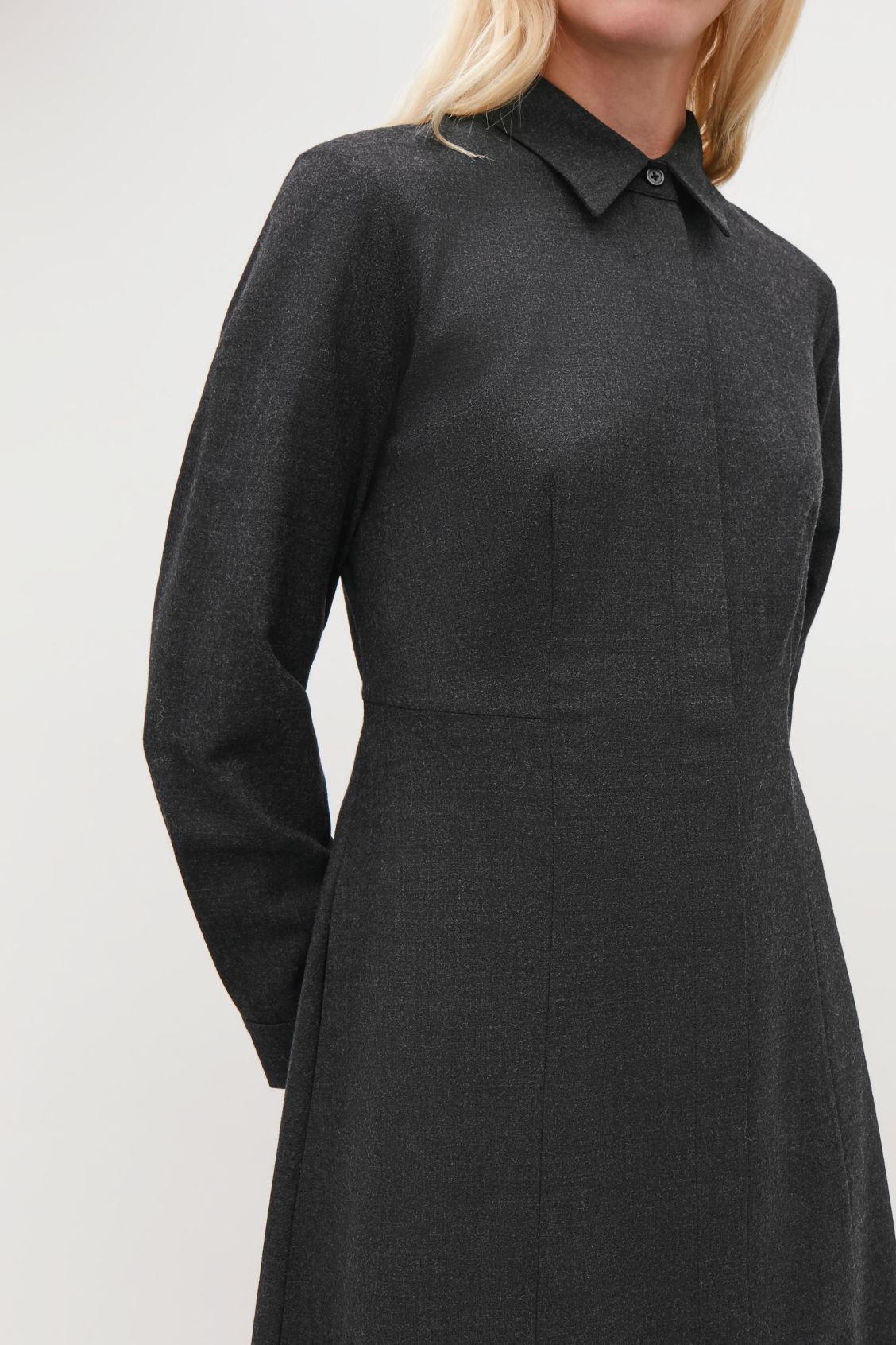 Model side image of Cos mid-length wool shirt dress in grey