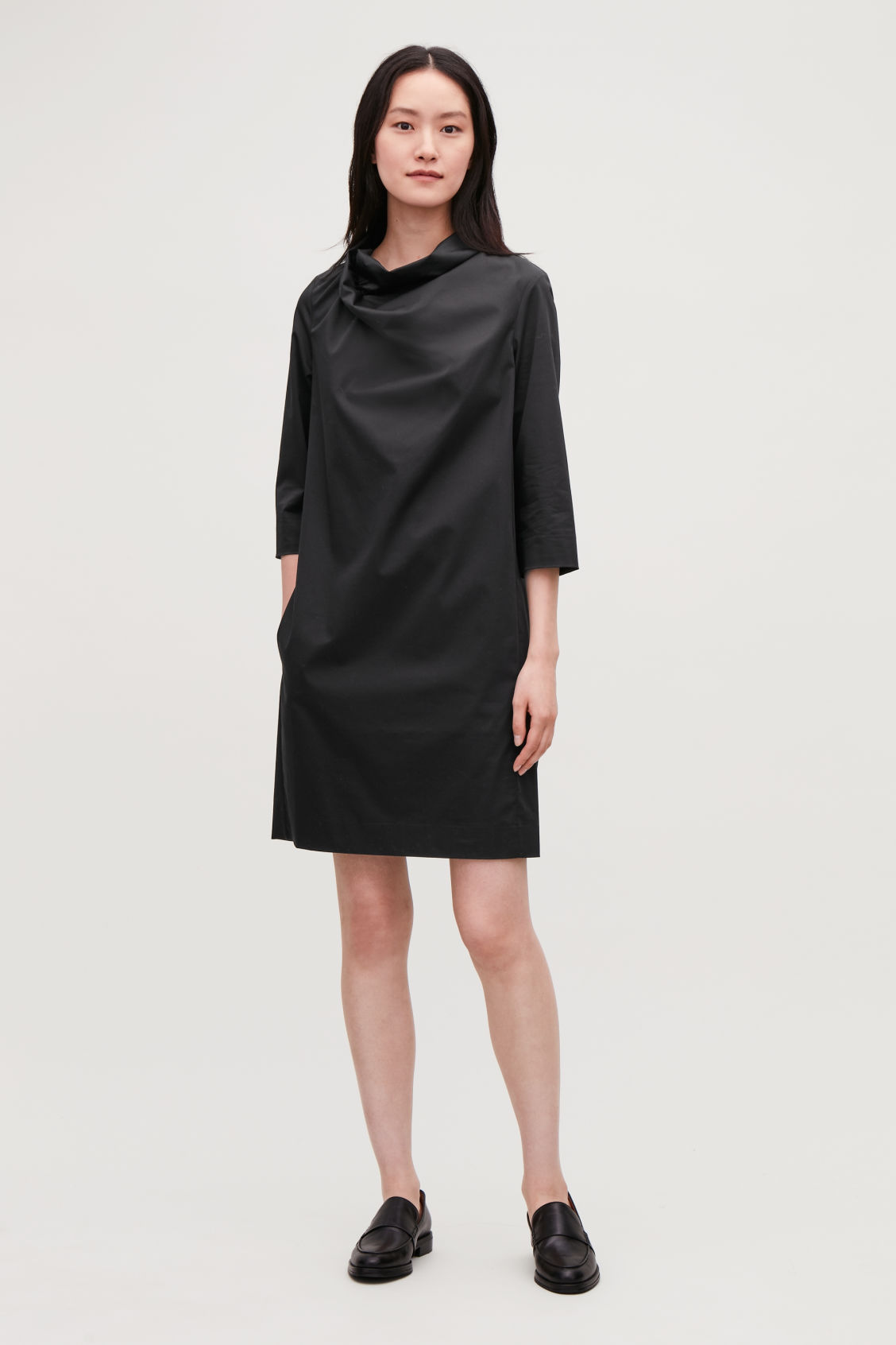 484c7d2e4b1161 Model front image of Cos draped-neck cotton dress in black