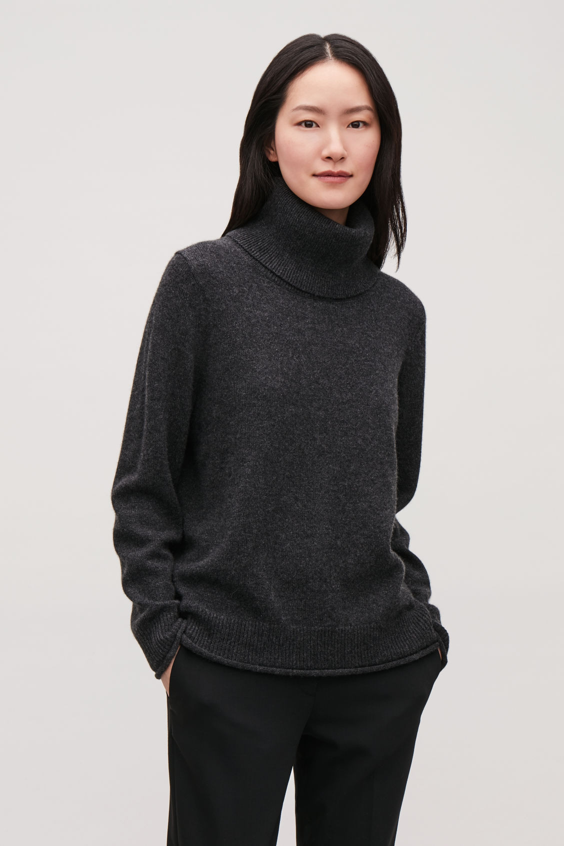 Model side image of Cos cashmere roll-neck jumper in grey