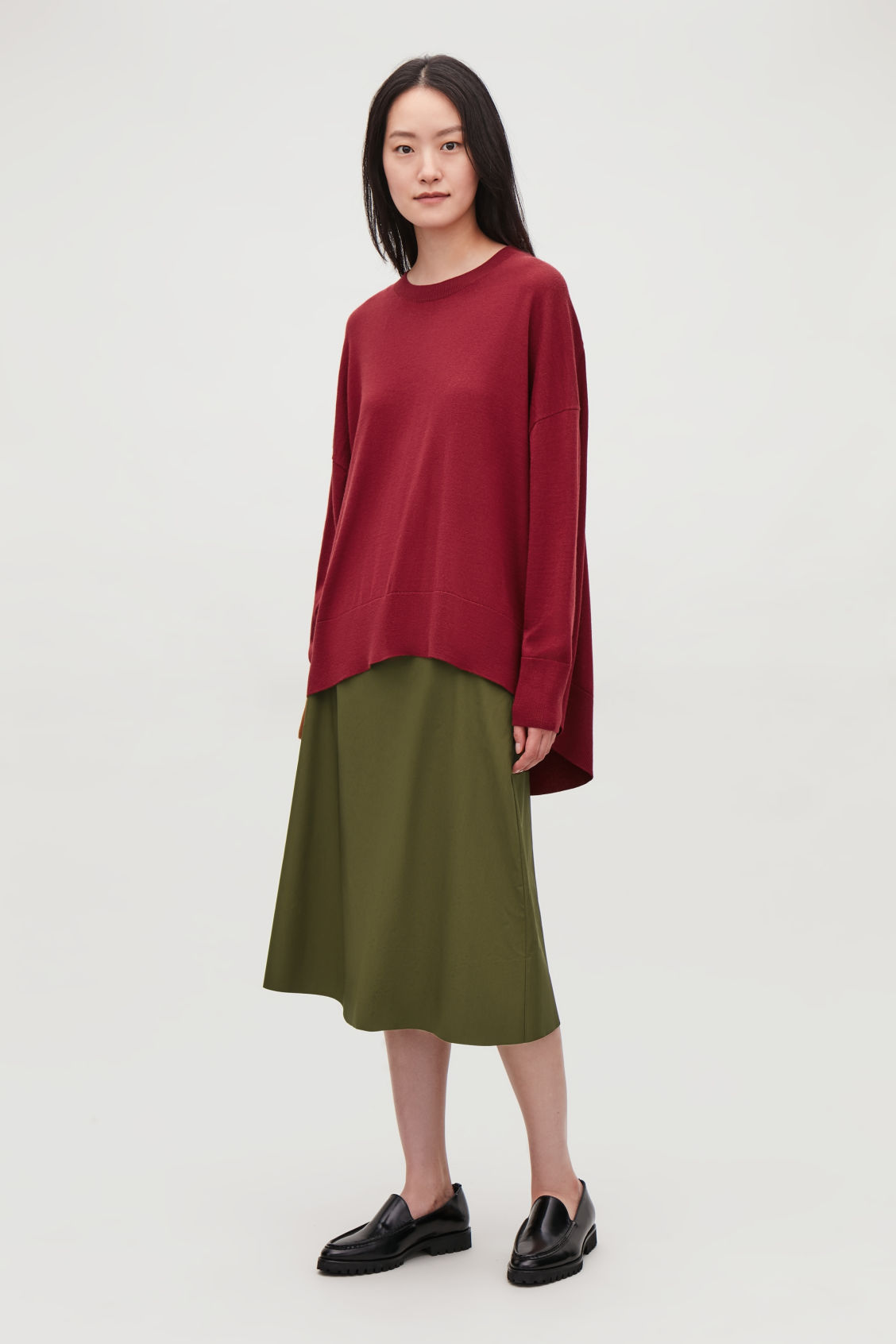 Model side image of Cos draped fine-knit wool jumper in red