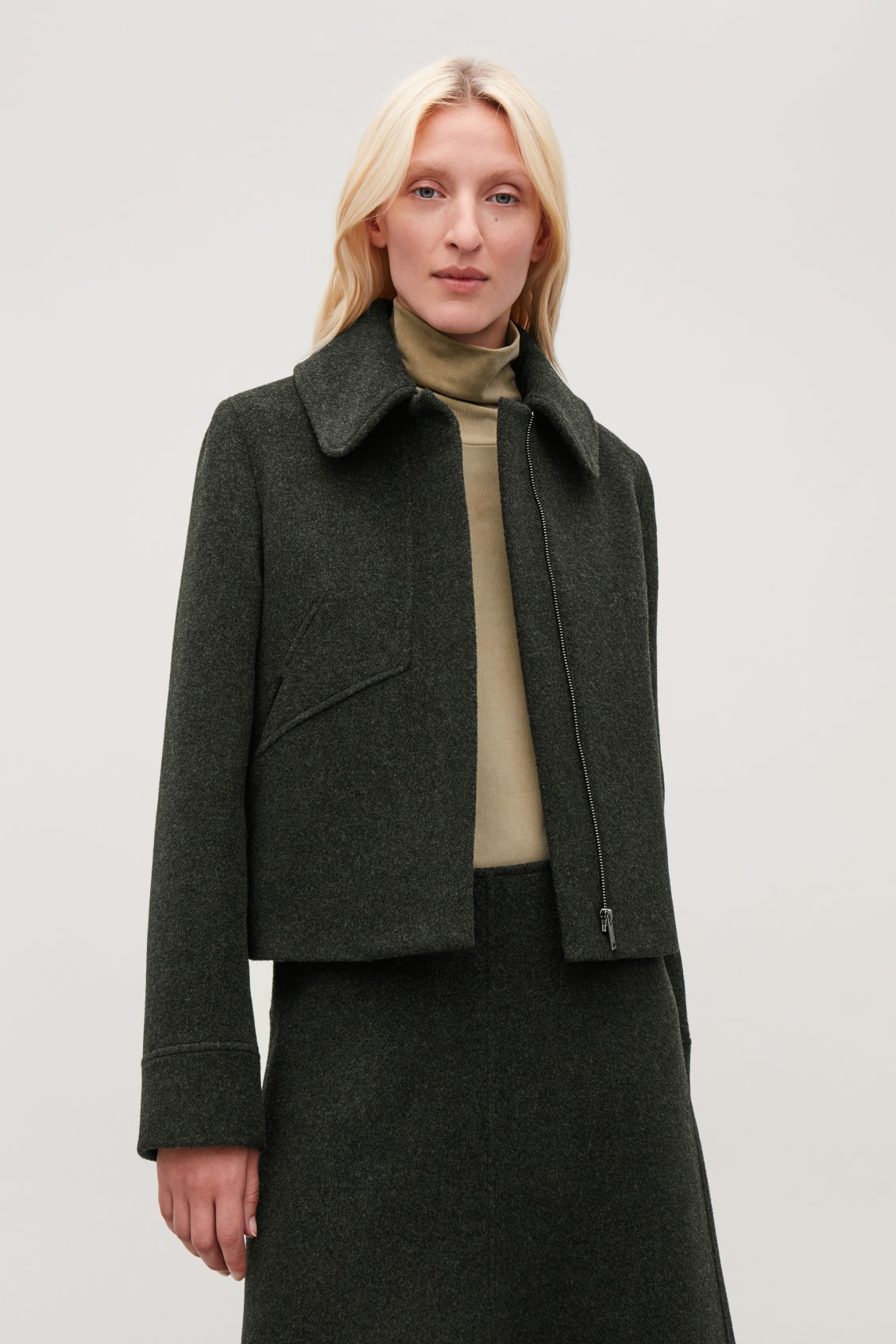 Model side image of Cos wool jacket with large collar in green