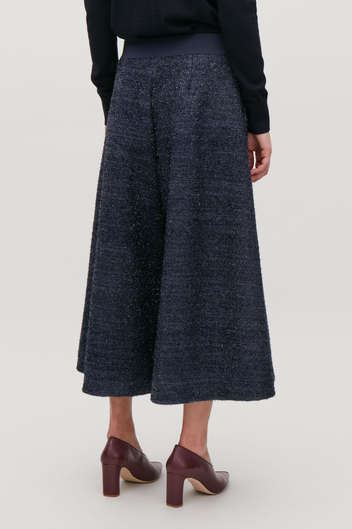 Model side image of Cos wide-leg tinsel culottes in blue