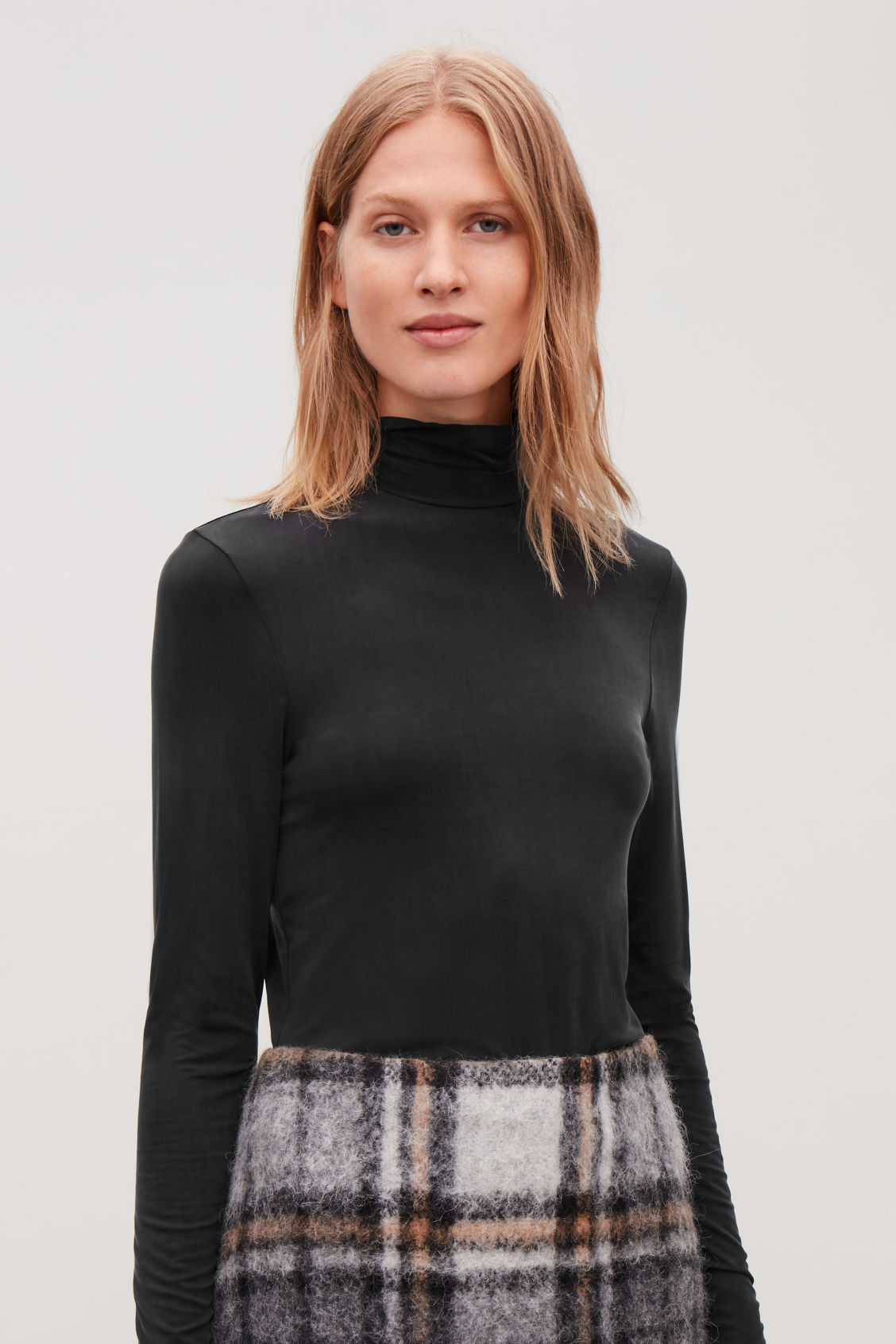 Model side image of Cos slim polo-neck top in black