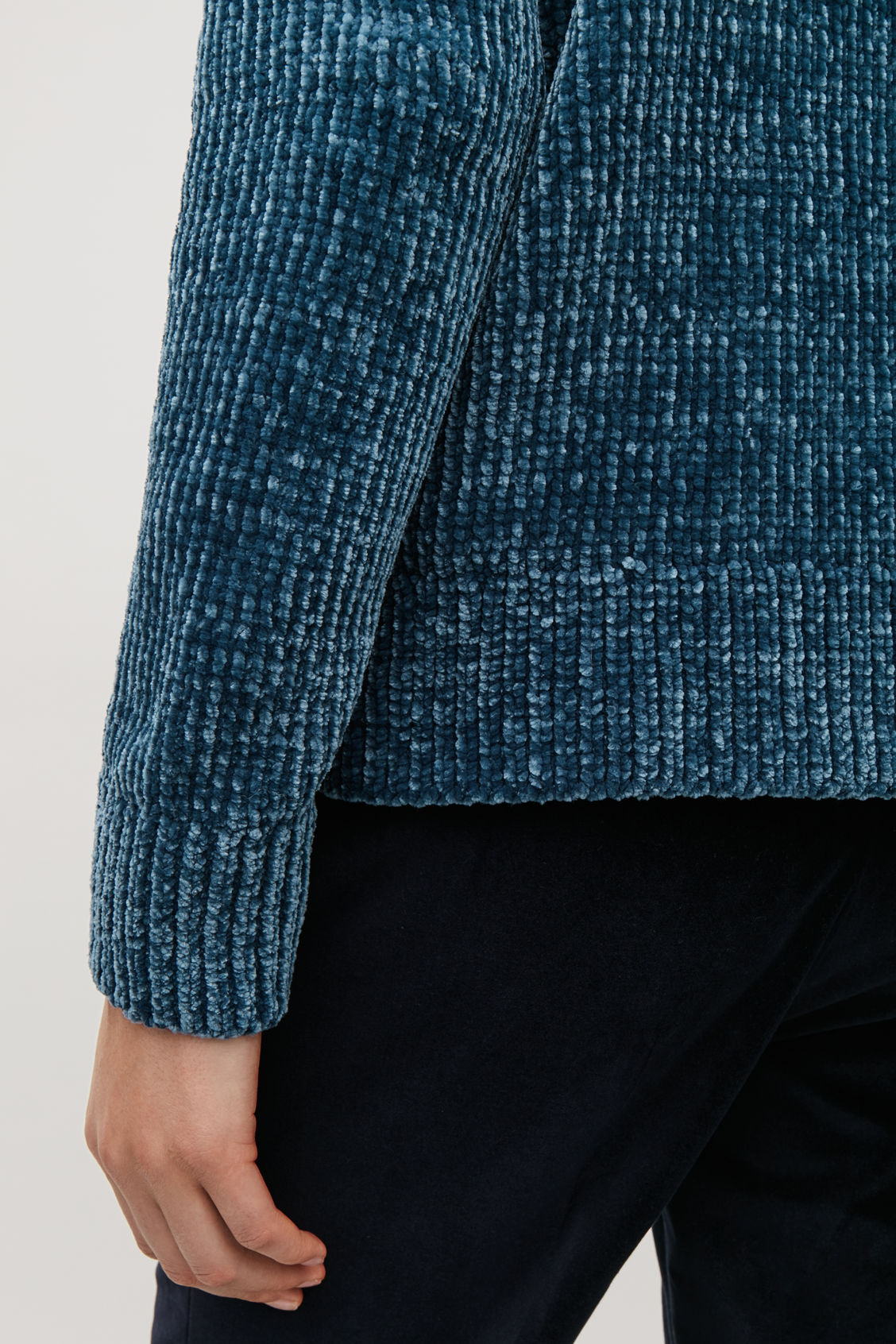 Model side image of Cos chenille jumper with zip in blue