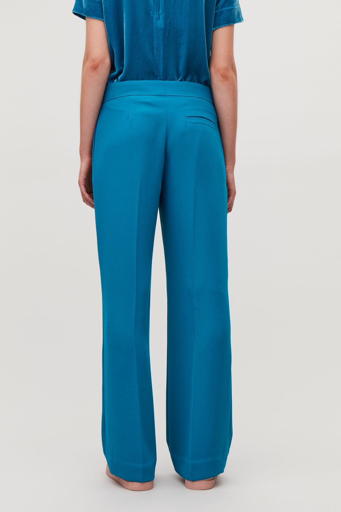 Model side image of Cos a-line tailored trousers in turquoise
