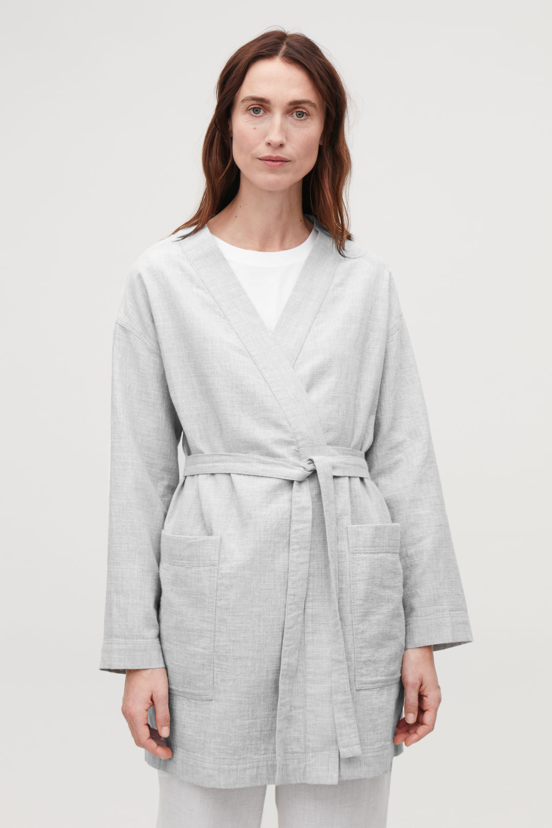 Model side image of Cos belted gown top in grey