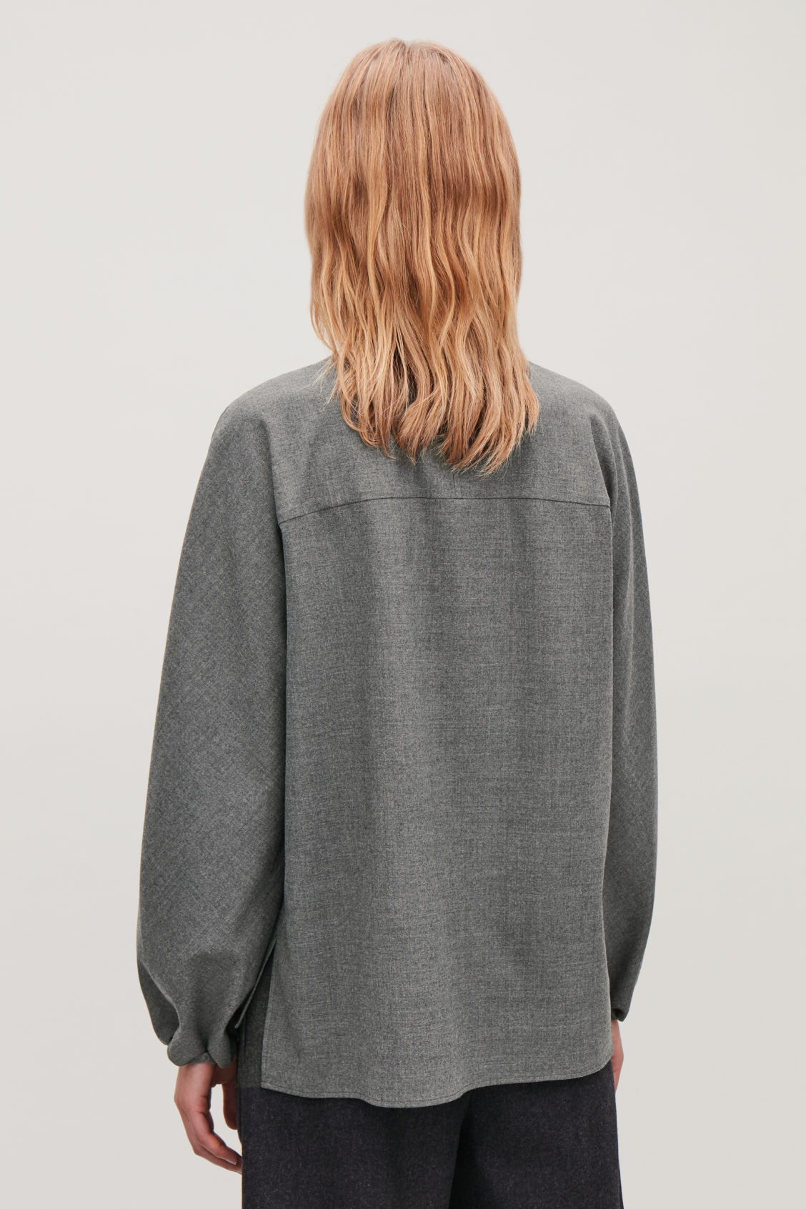 Model side image of Cos zip-front wool blouse  in grey