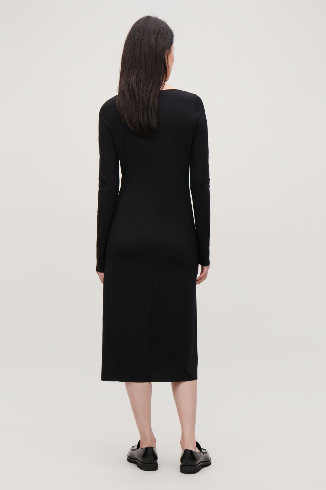 Model side image of Cos slim mid-length jersey dress in black