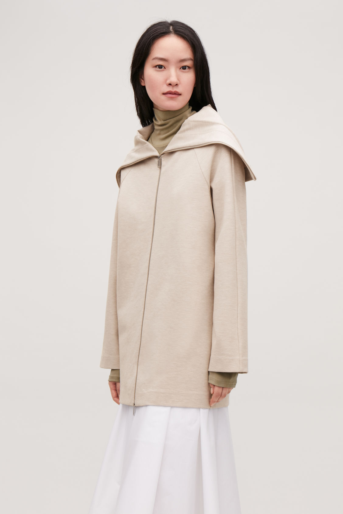 Model side image of Cos zip-up jacket with large collar in beige