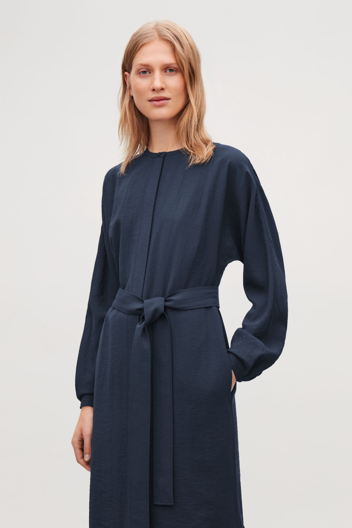 Model side image of Cos belted shirt dress in blue