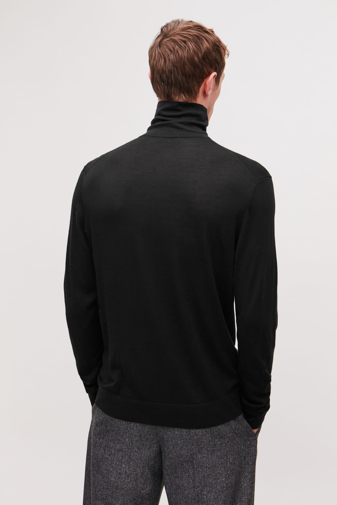 Model side image of Cos silk-merino roll-neck jumper in brown