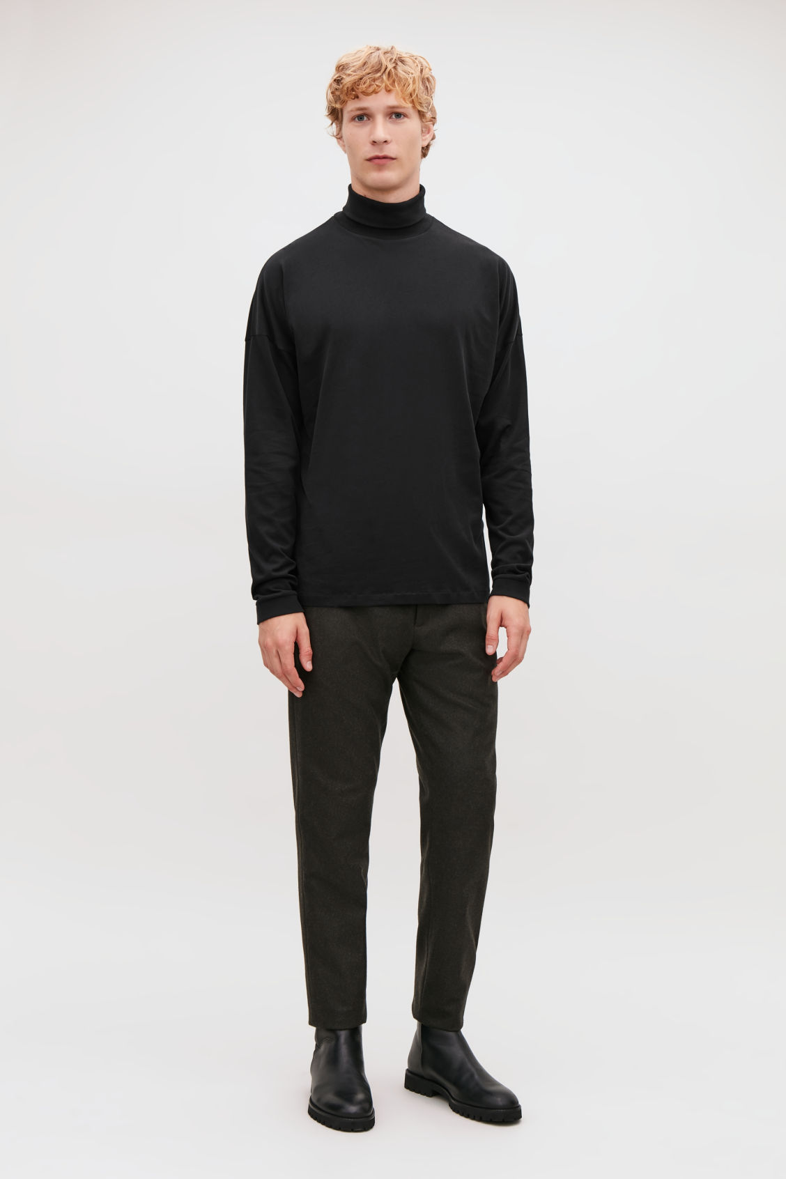 Model front image of Cos cotton roll-neck  jumper in black