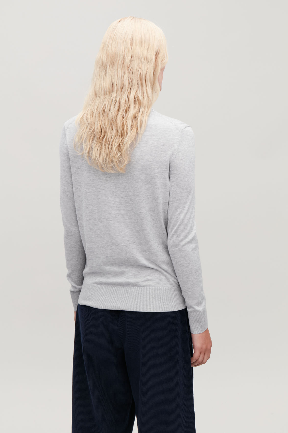 Model side image of Cos silk-cotton polo-neck top in grey