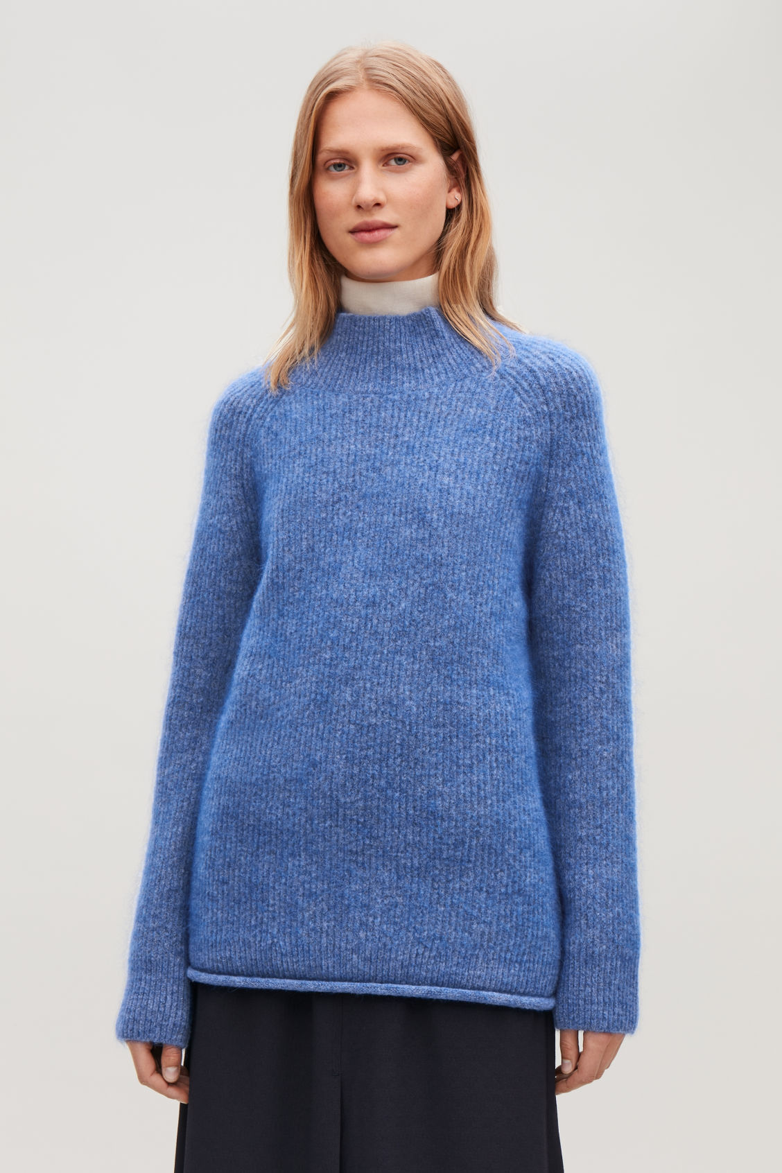 Model side image of Cos raised-neck chunky wool jumper in blue