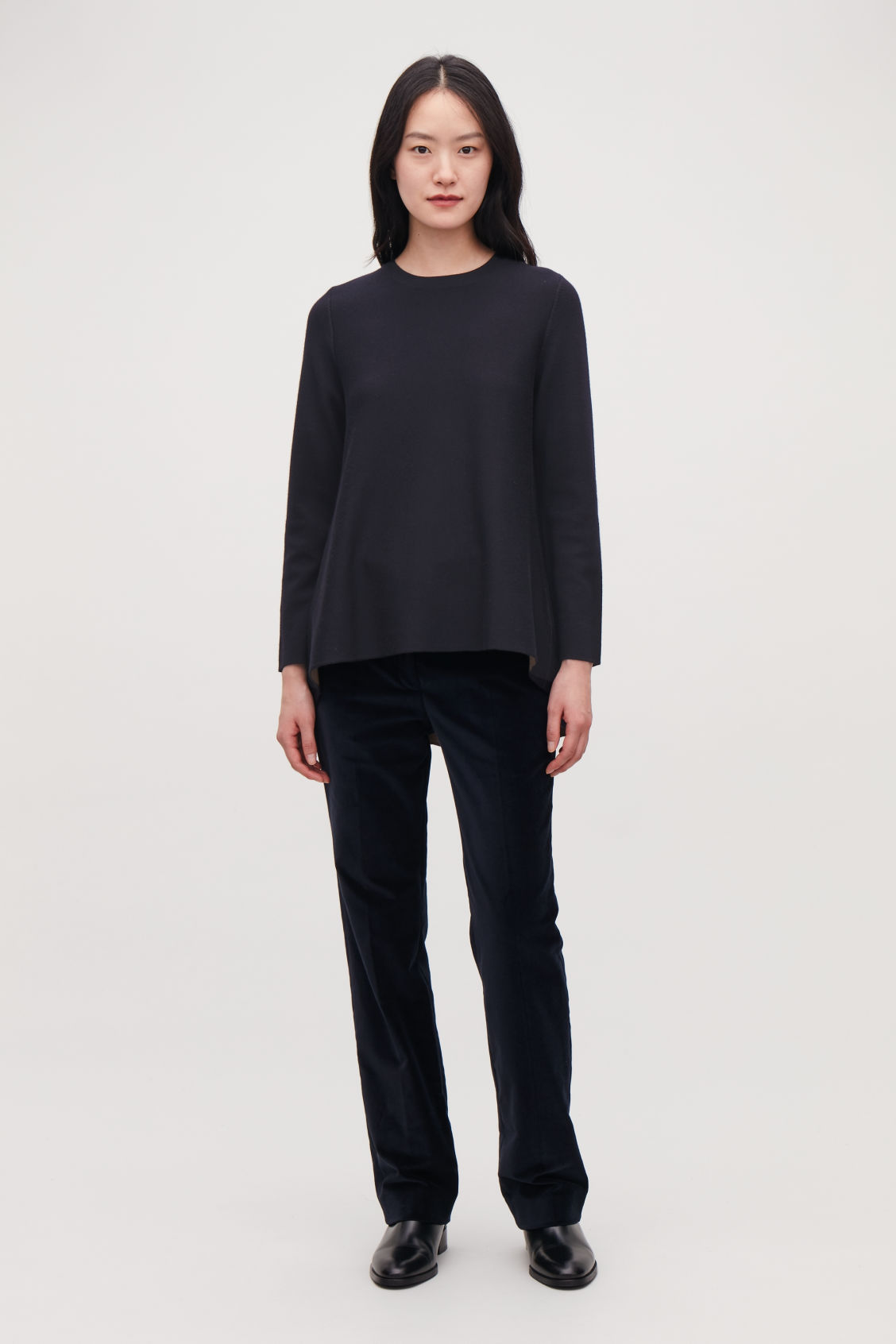 Model side image of Cos double-face merino wool jumper in blue