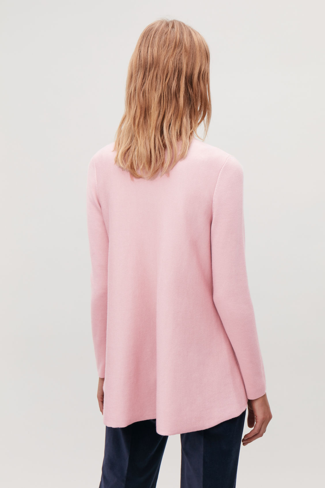 Model side image of Cos double-face merino wool jumper in pink