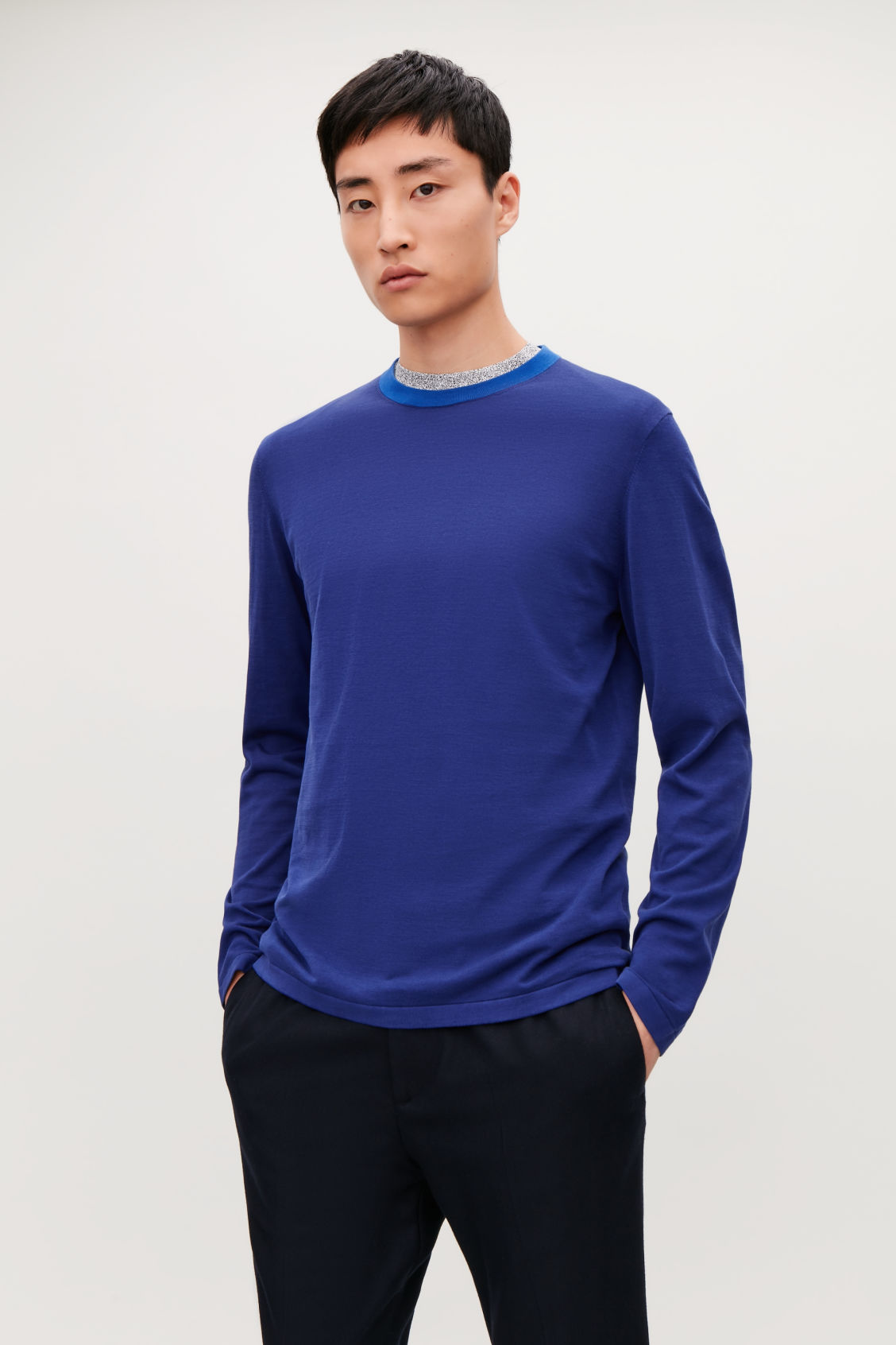 Model side image of Cos knitted colour-block top in blue