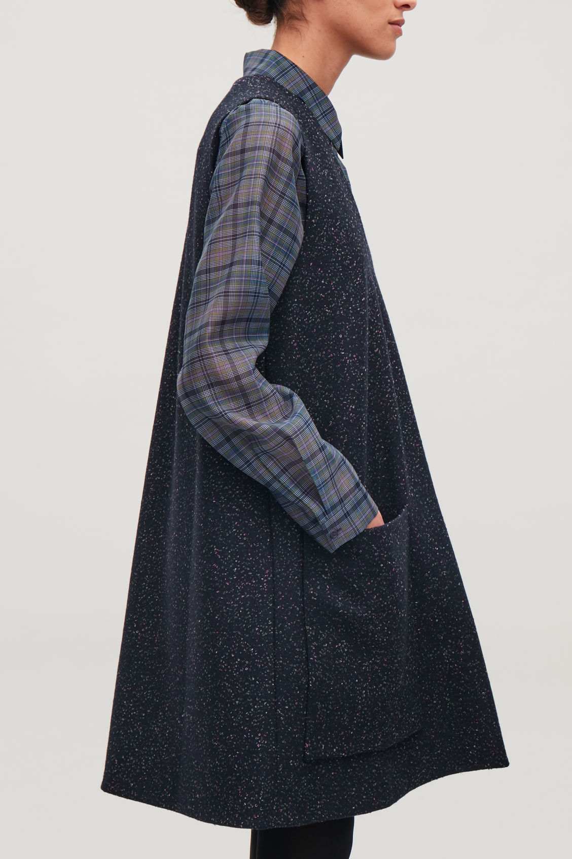 Model side image of Cos sleeveless a-line wool dress in blue