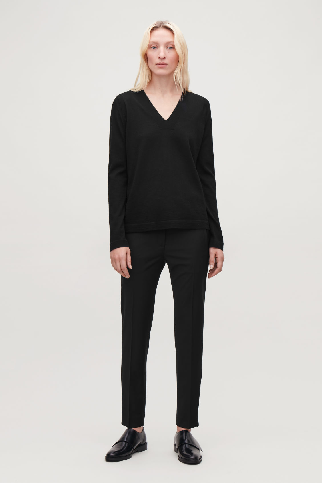 Model front image of Cos slim tailored trousers with zips in black