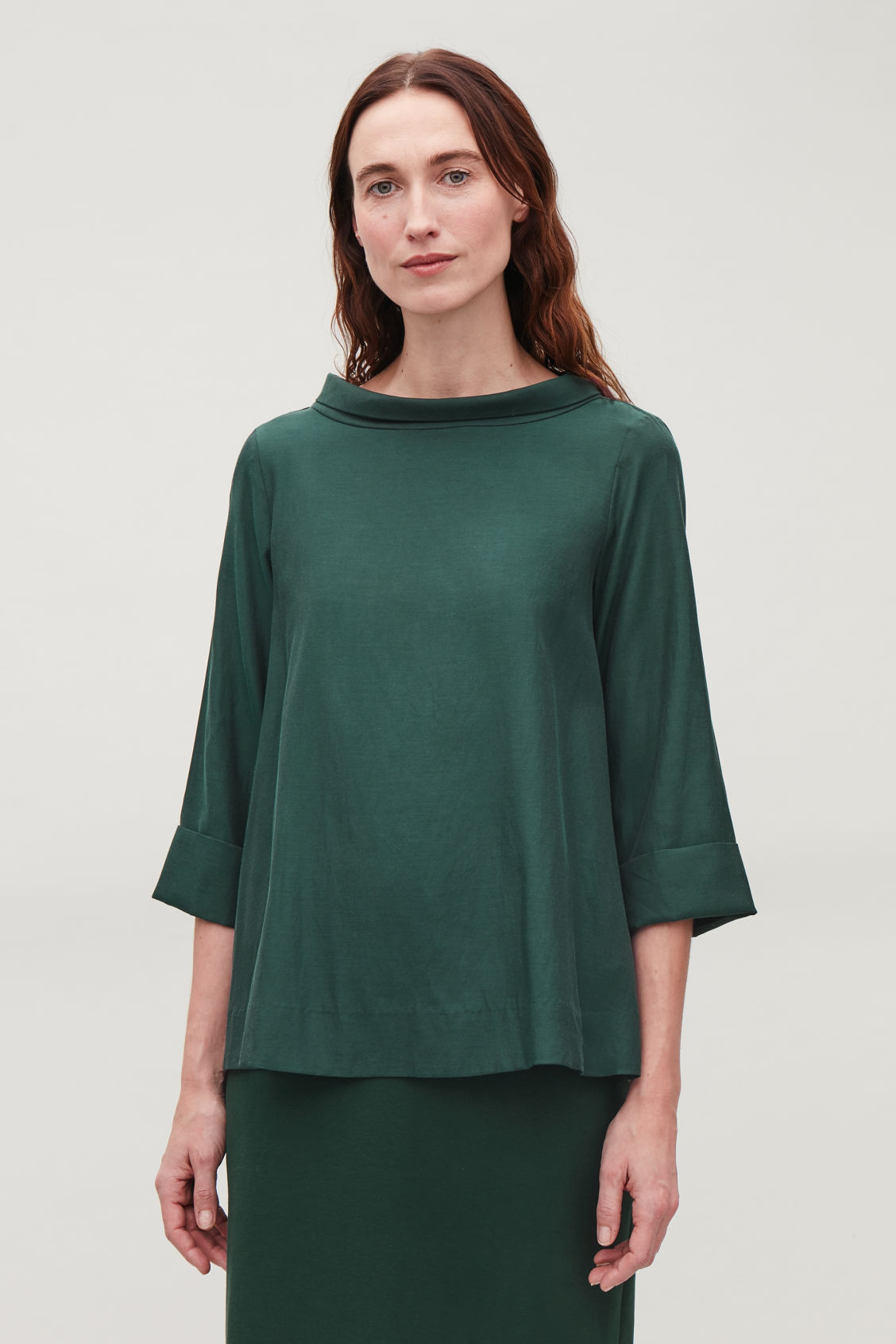 Model side image of Cos folded-collar draped blouse in green