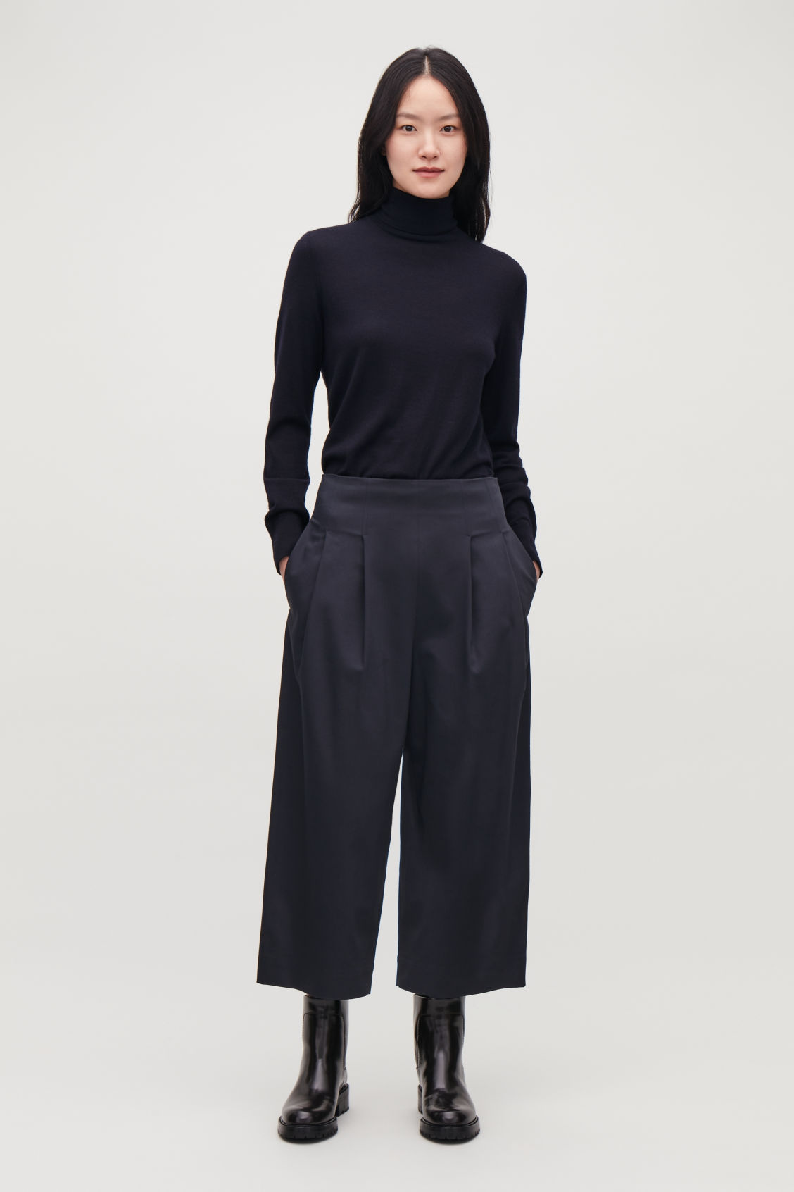Model front image of Cos stretch-cotton pleated trousers in blue