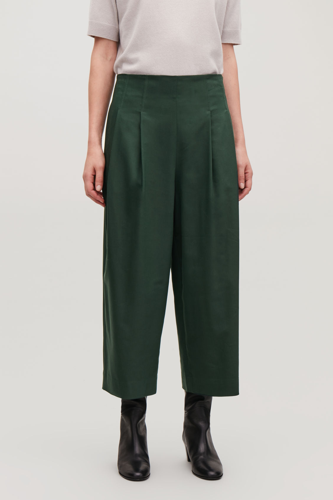 Model side image of Cos crop cotton pleated trousers in green