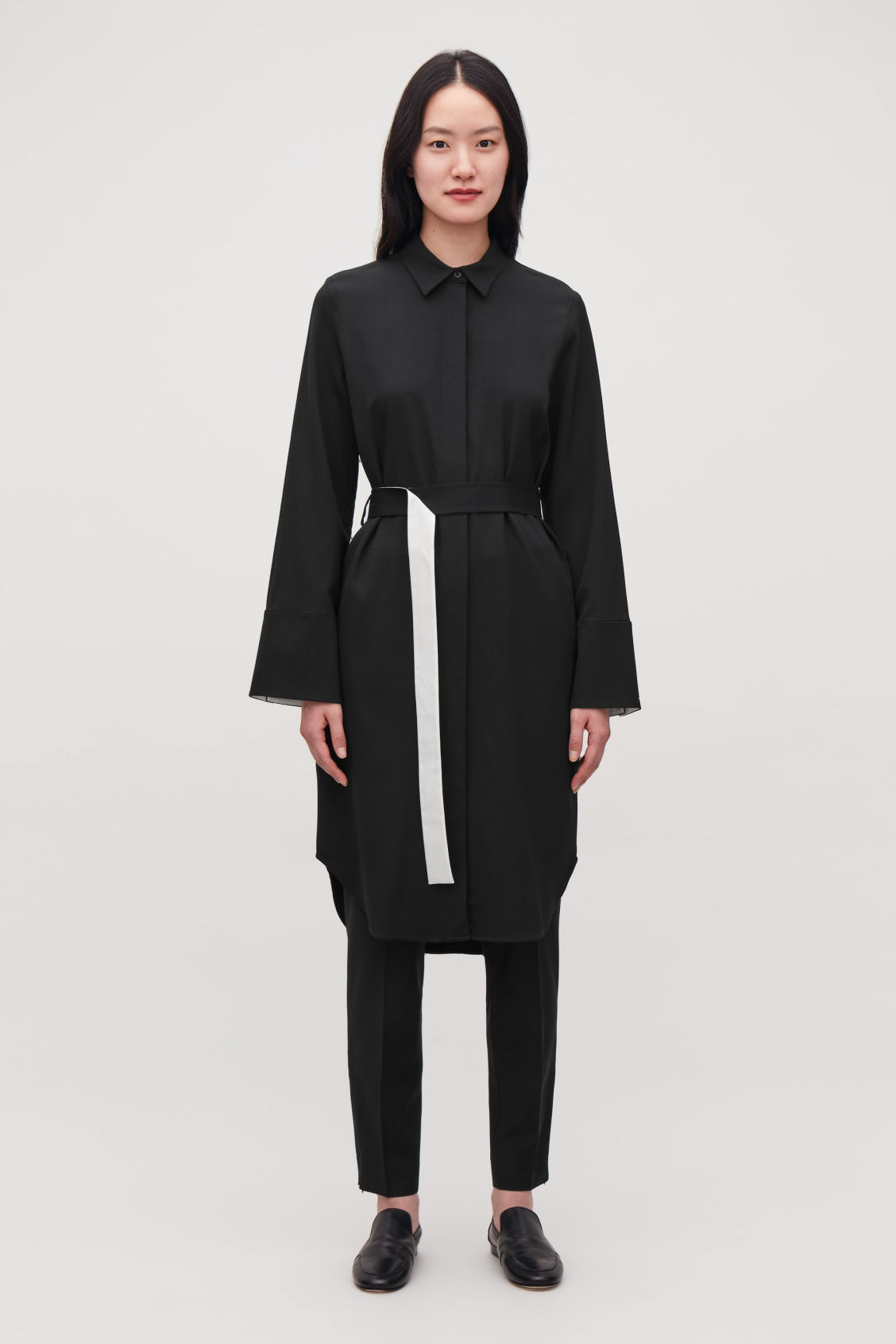 Model front image of Cos shirt dress with flared sleeves in black