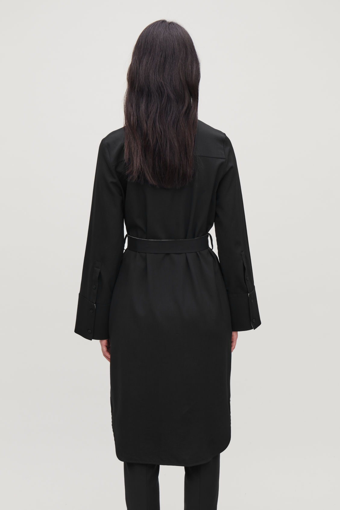 Model side image of Cos shirt dress with flared sleeves in black