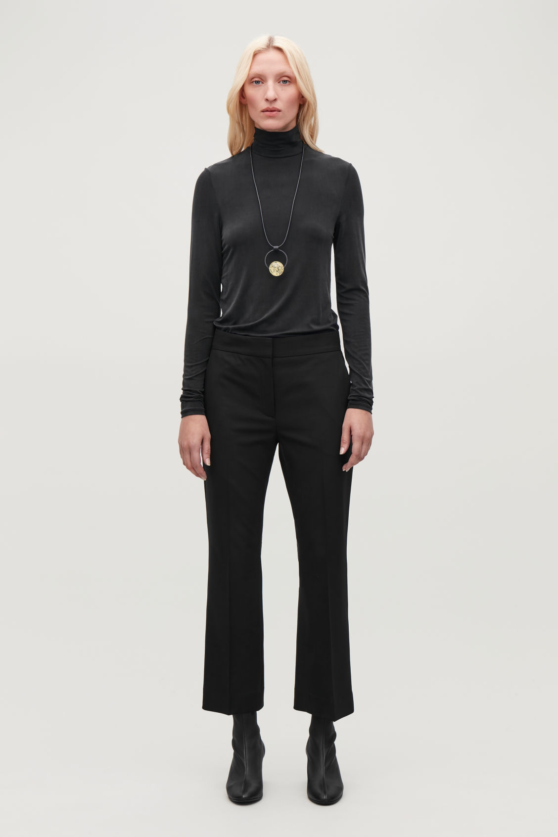 Model front image of Cos crop kick-flare wool trousers in black