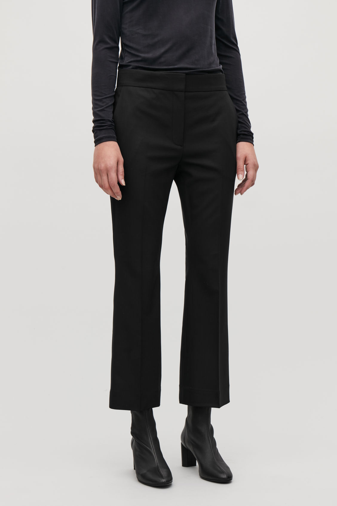 Model side image of Cos crop kick-flare wool trousers in black