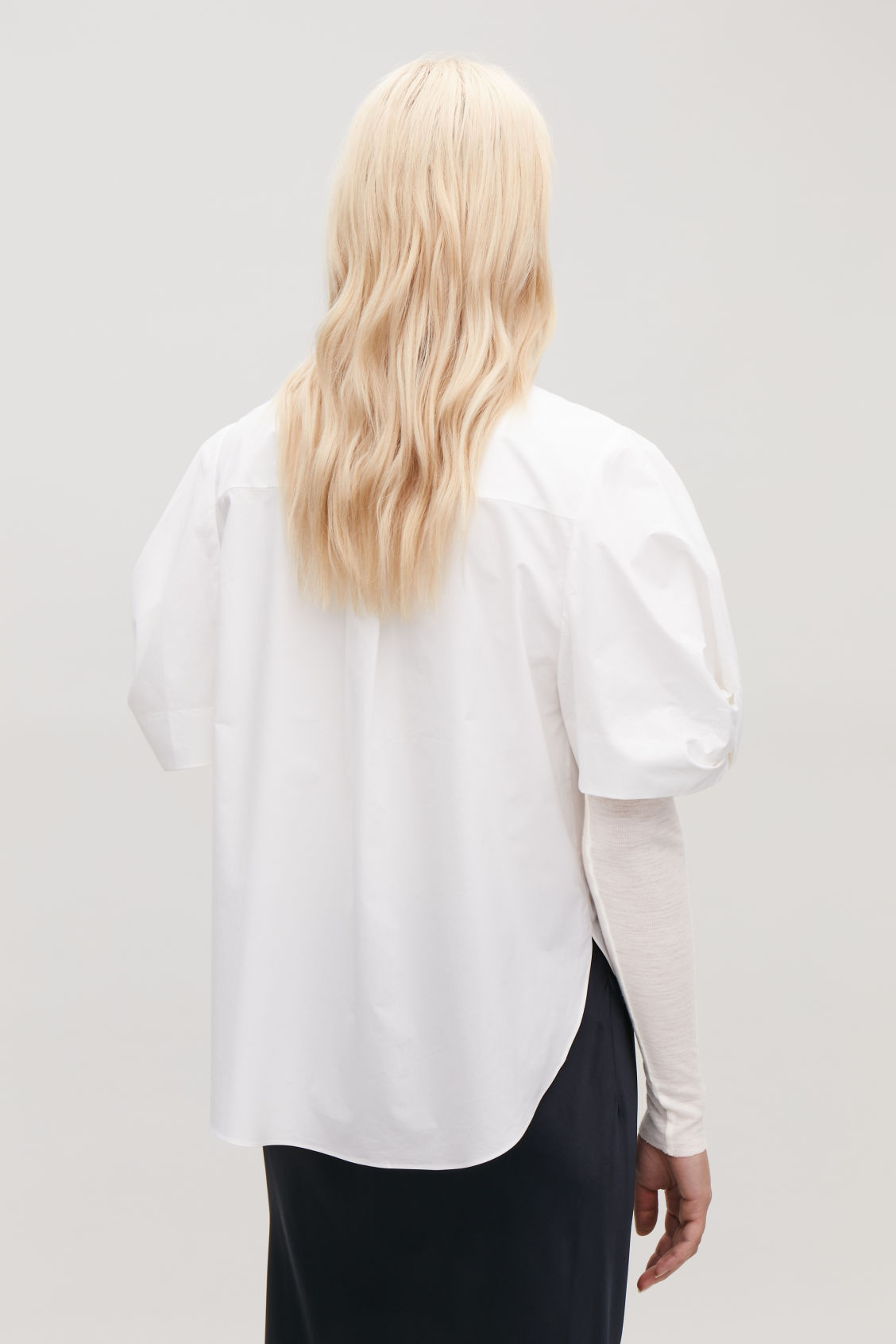 Model side image of Cos bow-detail short-sleeved shirt in white