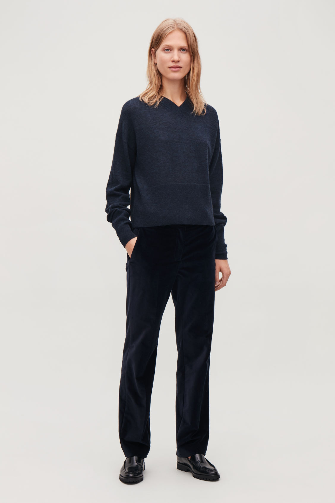 Model front image of Cos boxy wool v-neck jumper in blue
