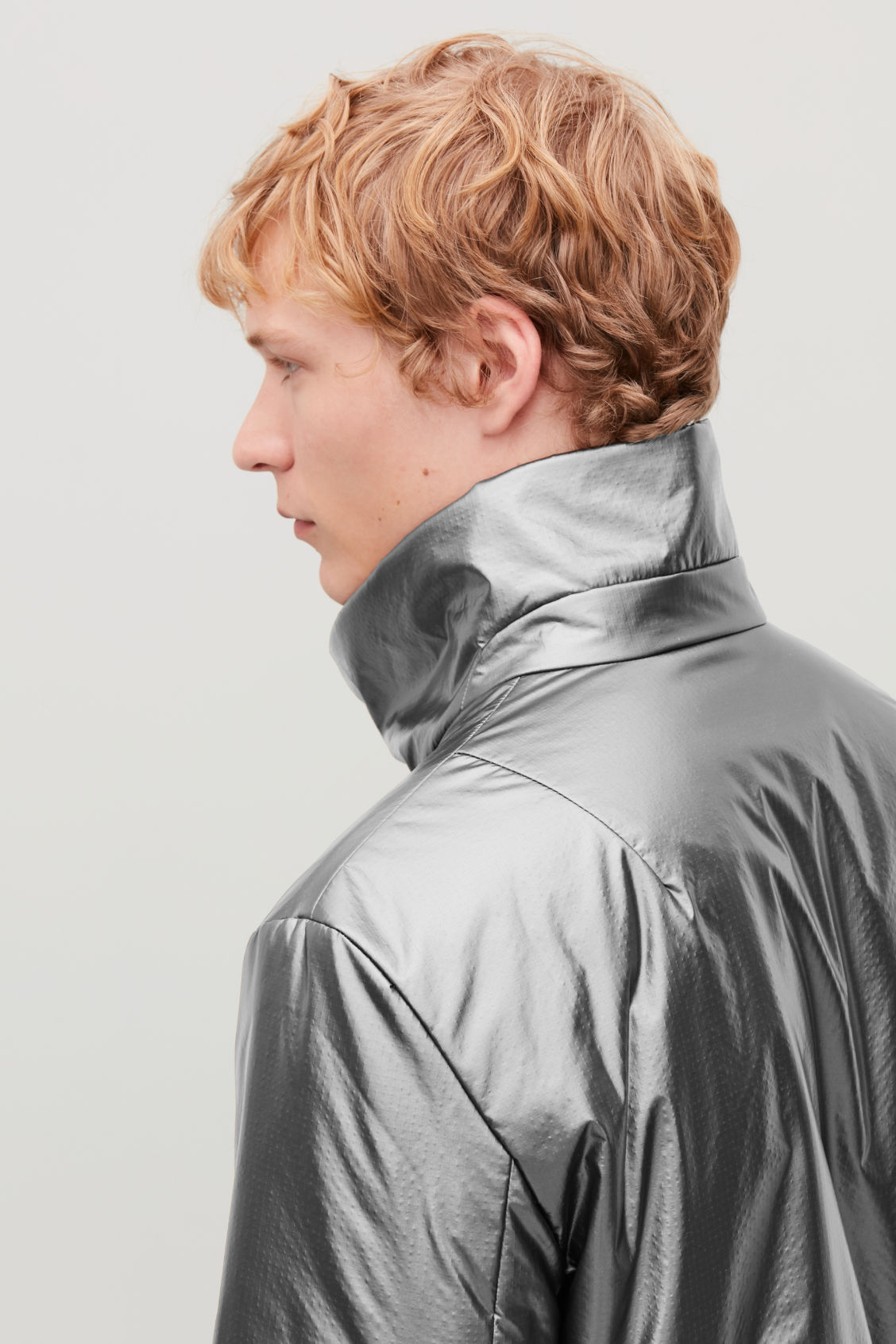 Model side image of Cos padded high-neck jacket in grey