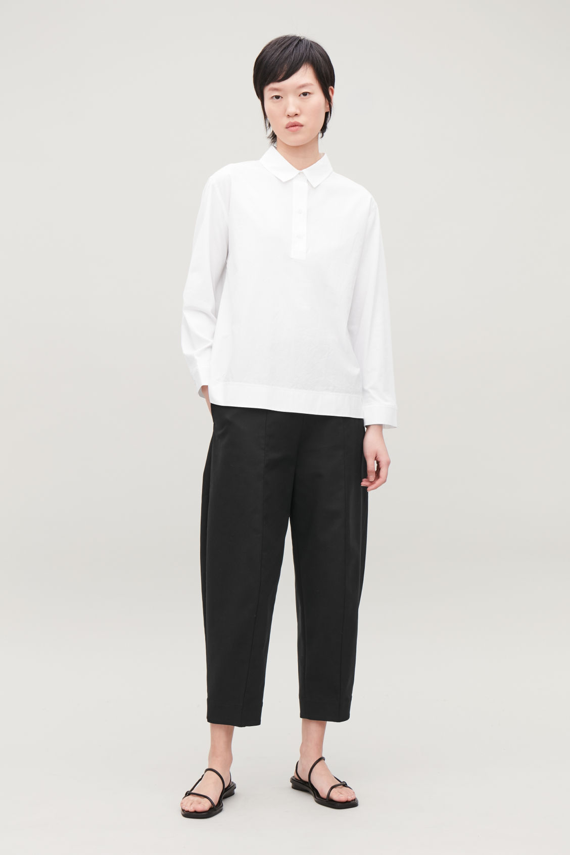 Model side image of Cos woven-jersey mix shirt in white