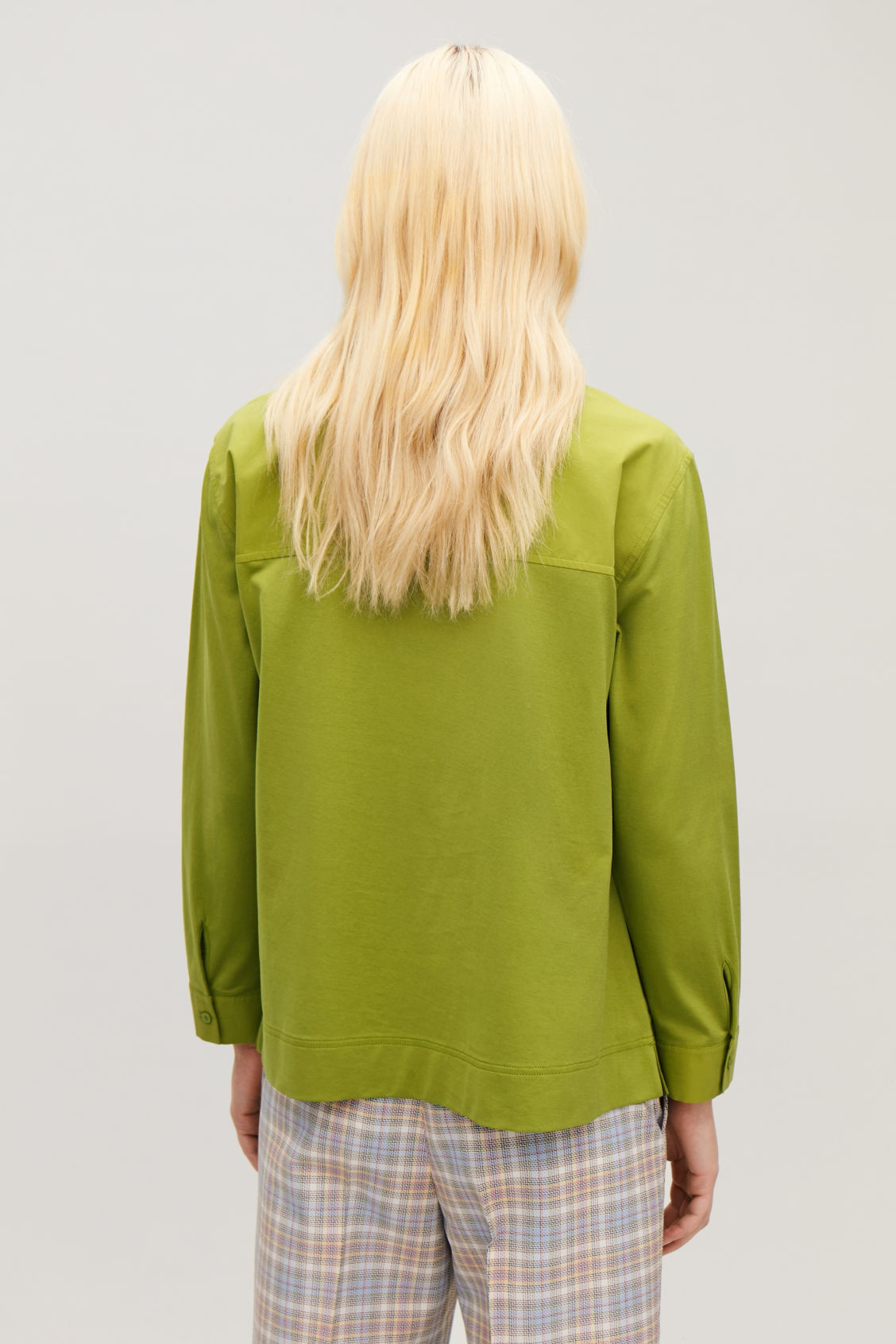 Model side image of Cos woven-jersey mix shirt in green
