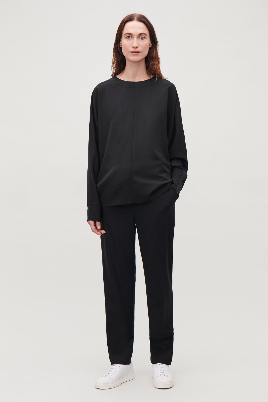 Model front image of Cos woven-jersey mix sweatshirt  in black