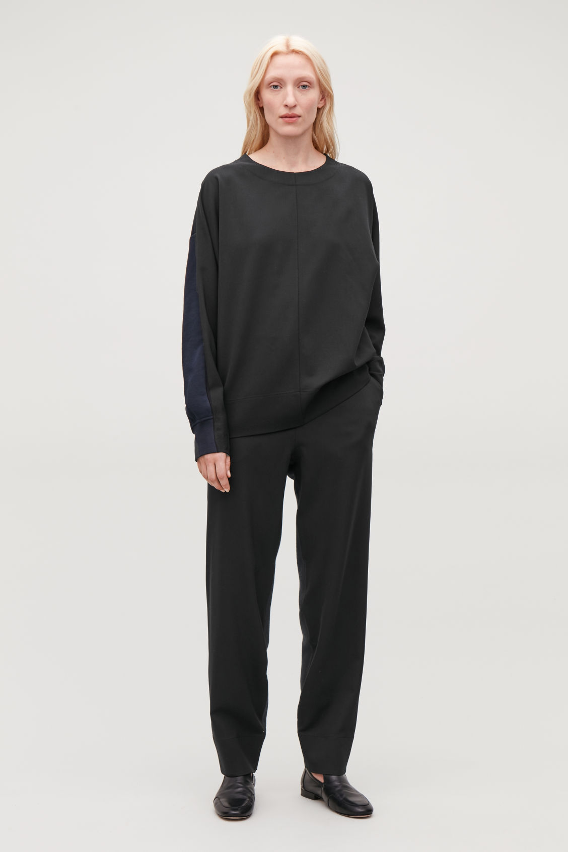 Model front image of Cos woven-jersey mix trousers in black