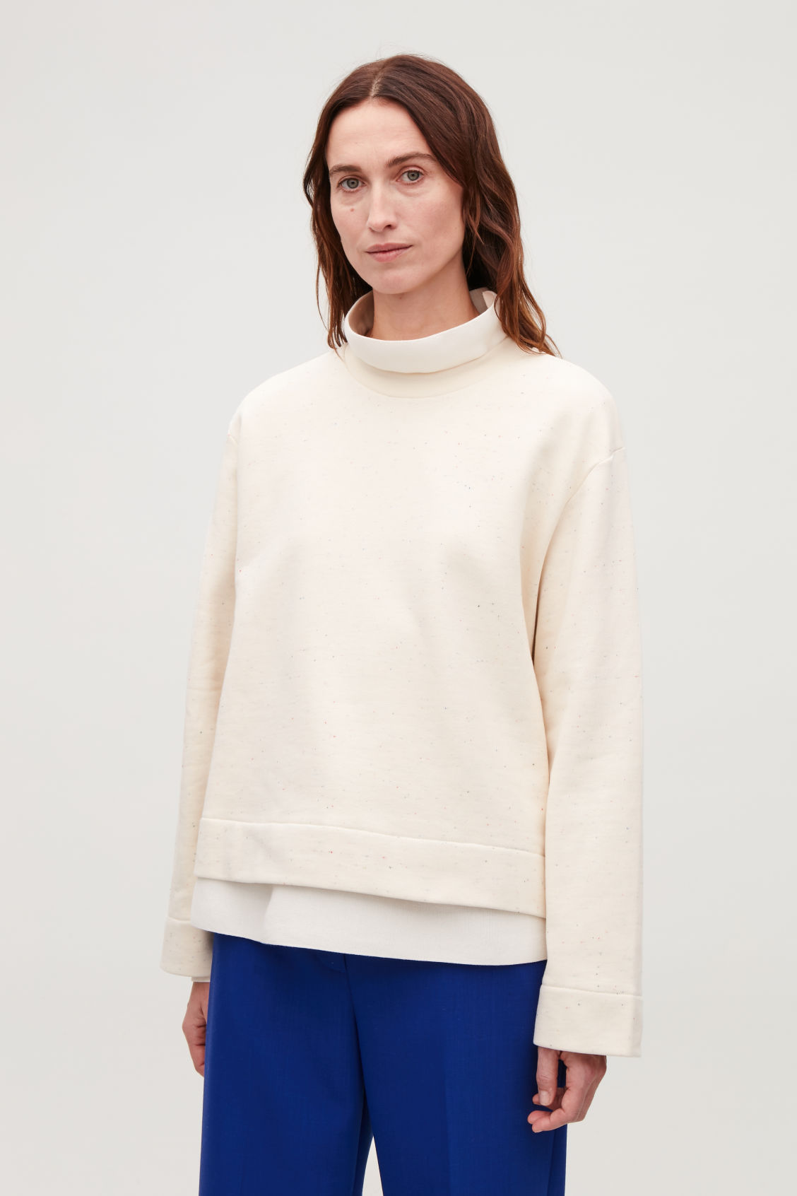 Model side image of Cos speckled jersey sweatshirt in beige