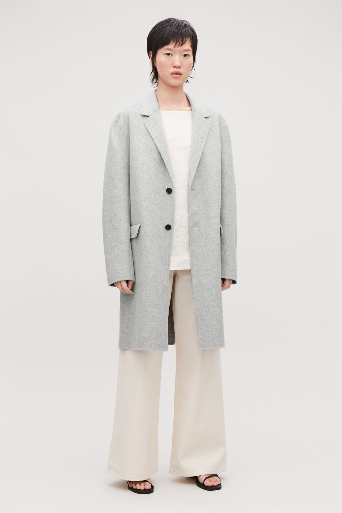 Model side image of Cos deconstructed wool coat  in grey