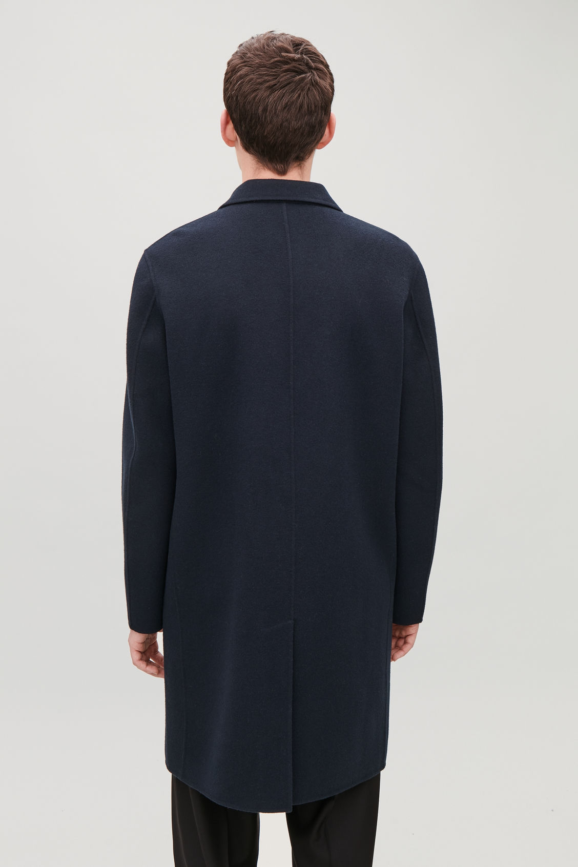 Model side image of Cos deconstructed wool coat  in blue