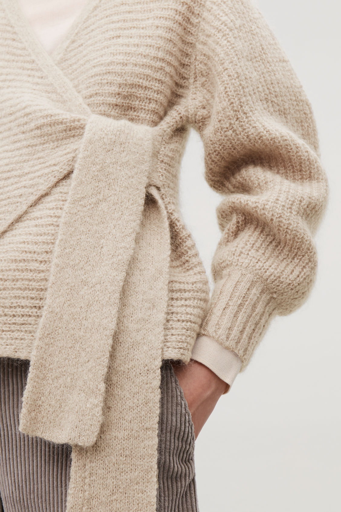 Model side image of Cos chunky wool wrap cardigan in brown