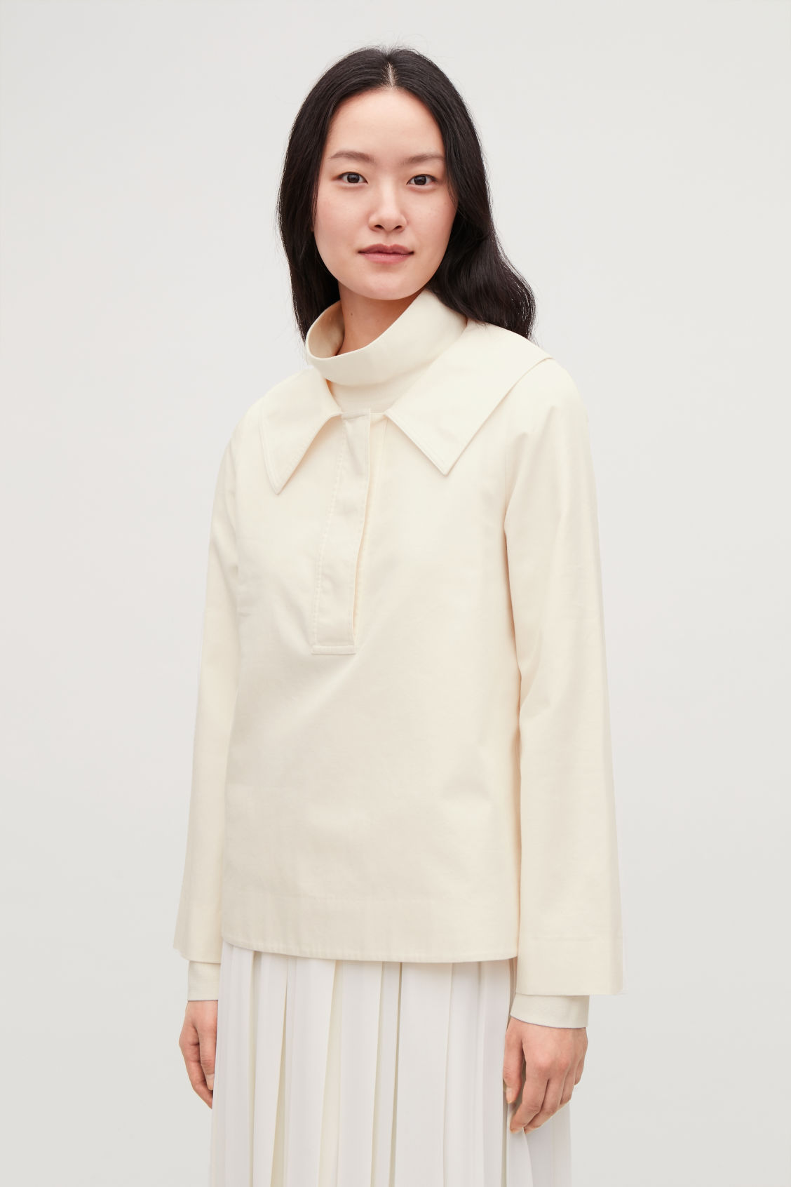 Model side image of Cos oversized-collar cotton top in white