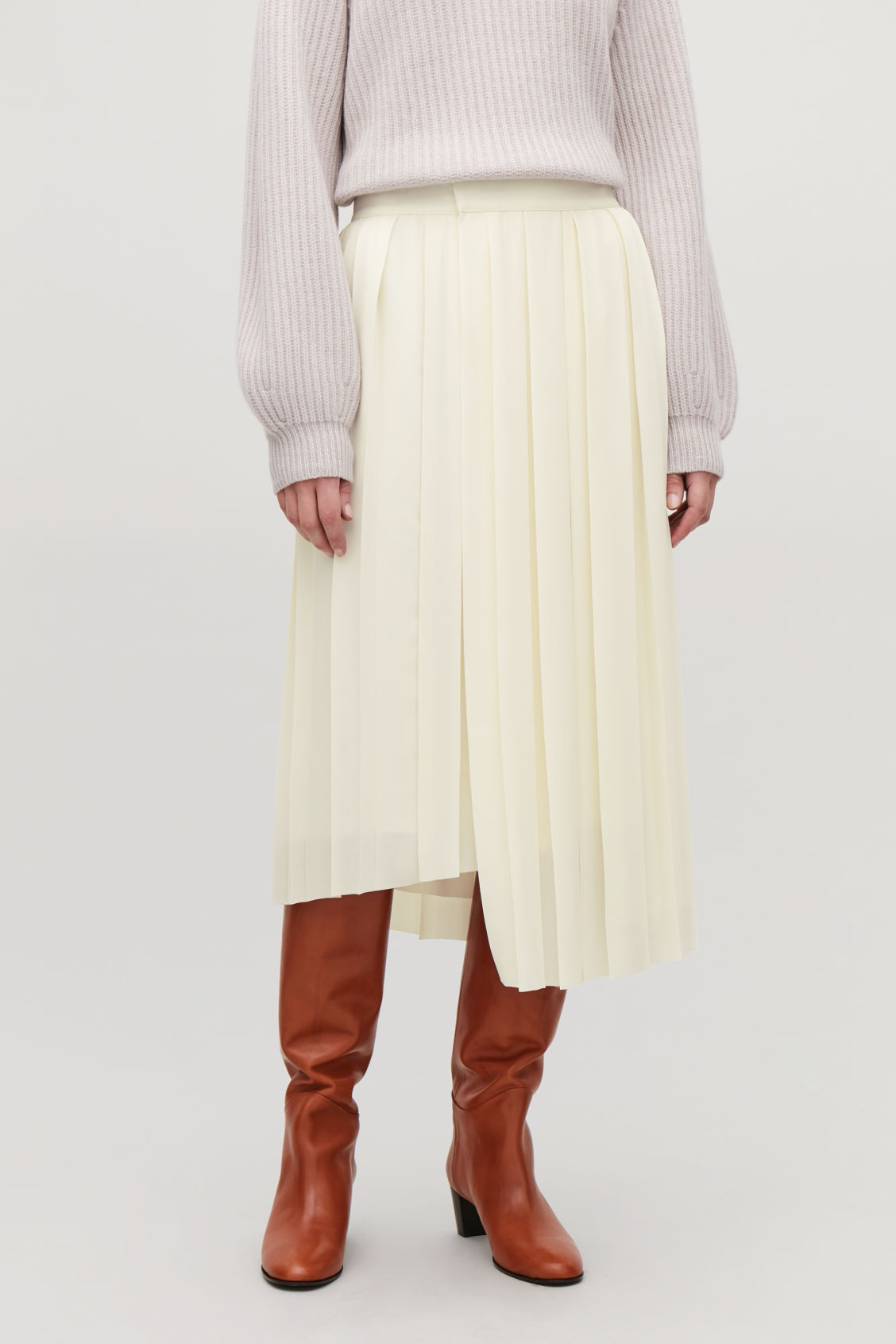 Model side image of Cos asymmetric pleated wrap skirt in white