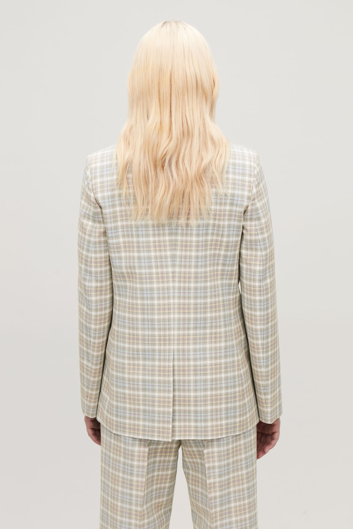 Model side image of Cos checked slim-fit blazer in beige