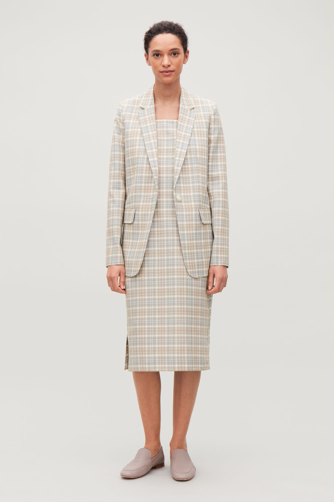 Model side image of Cos checked slim-fit blazer in white
