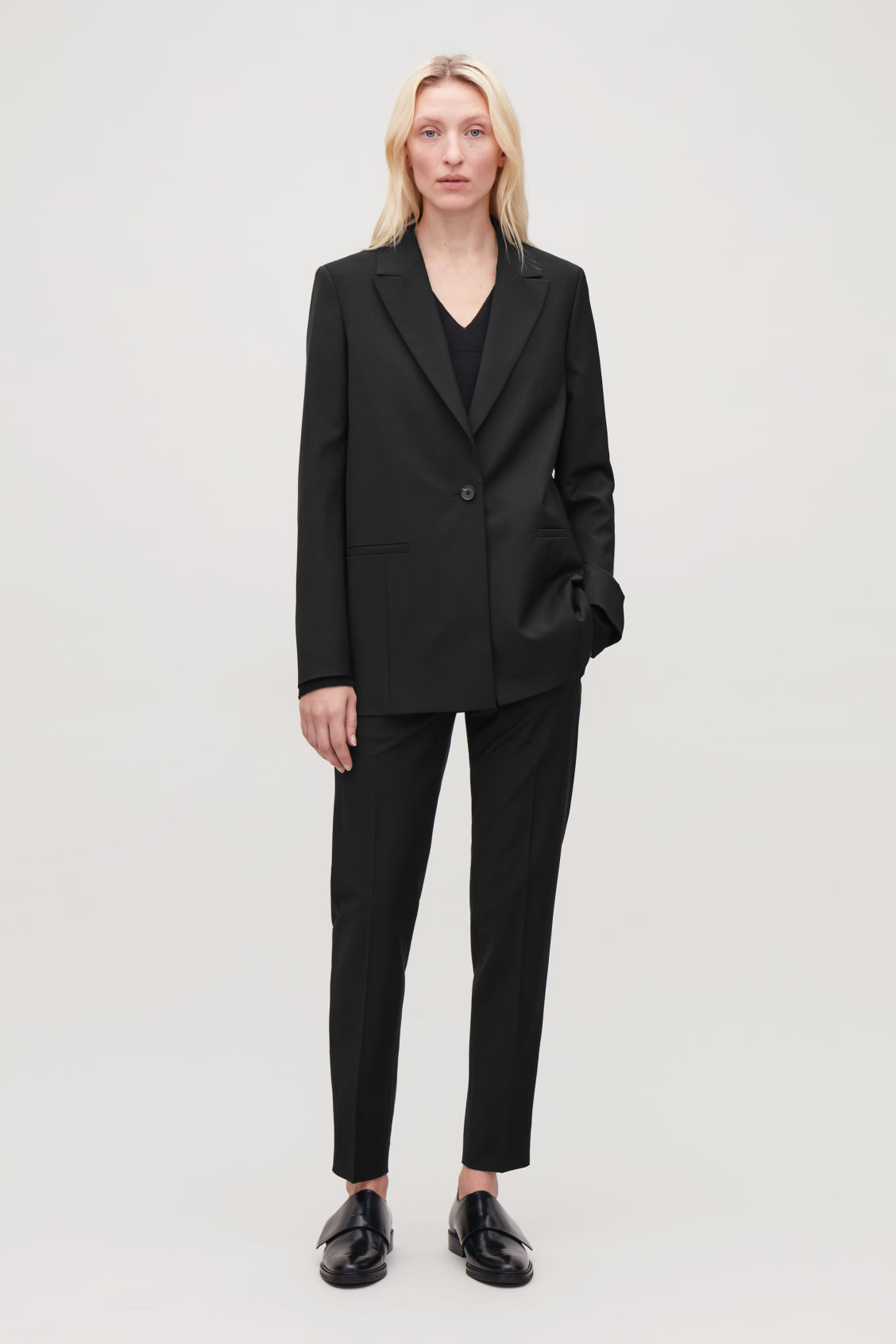 Model front image of Cos single-breasted blazer with zips in black