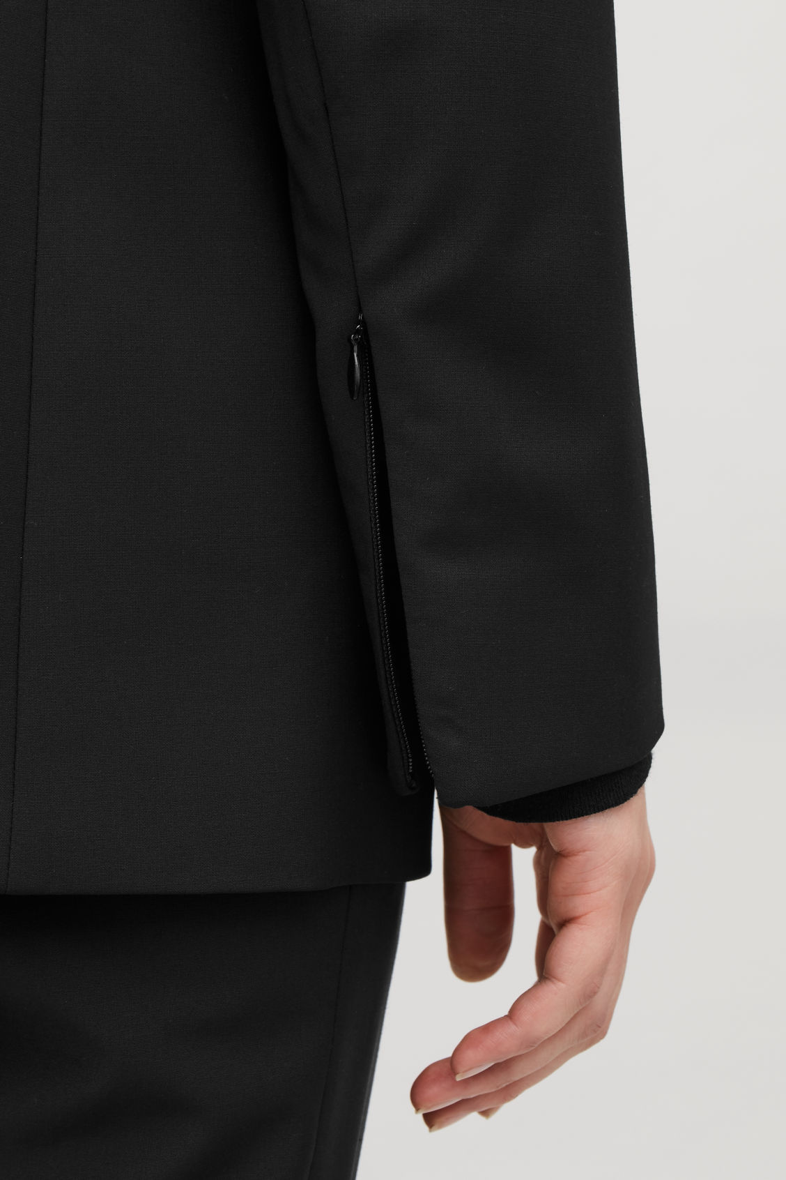 Model side image of Cos single-breasted blazer with zips in black